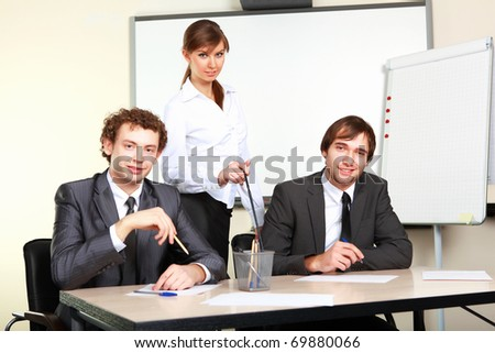 three collegues in an office discussing business