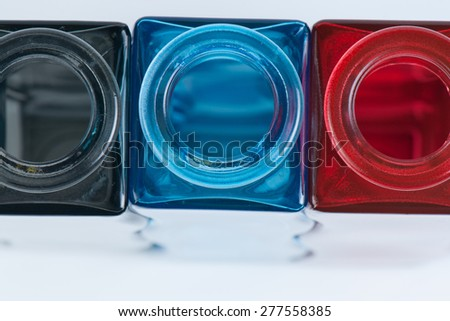 three color modern flower vases, top view - stock photo