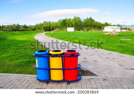 three color of litter bin at public park - stock photo