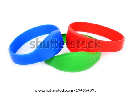 three color rfid bracelet on a white background - stock photo