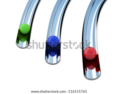 Three colored balls roll along a trajectory - stock photo