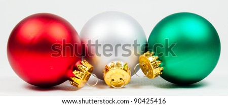 Three colored christmas ornaments - stock photo