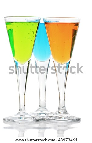 Three colored cocktails with reflections against white background