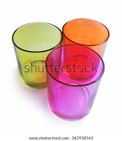 Three colored drinking glasses, isolated on white. - stock photo
