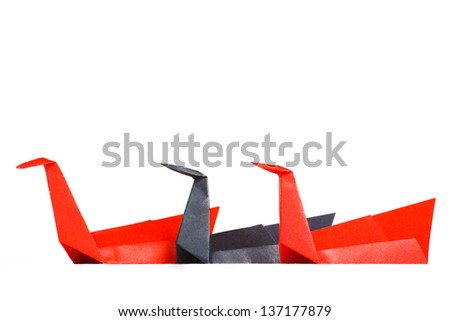 Three colored paper swan on a white background