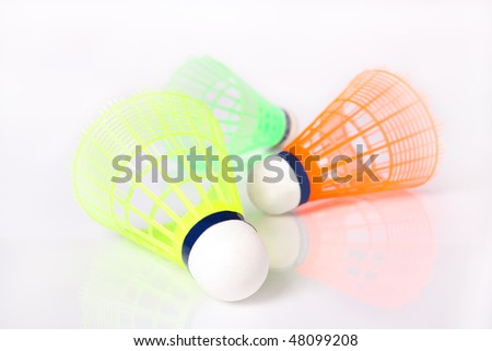 Three colored shuttle badminton on a white background