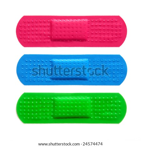 Three colorful bandages isolated in white background - stock photo