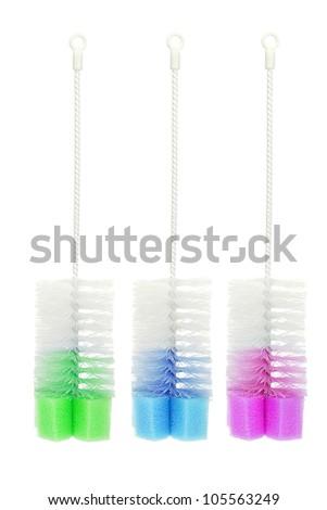 Three Colorful Bottle Brushes on White Background - stock photo