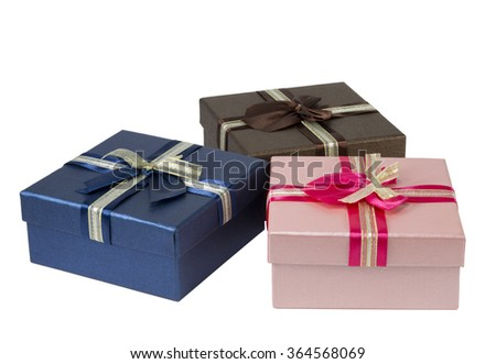 Three colorful gift boxes on white background isolated