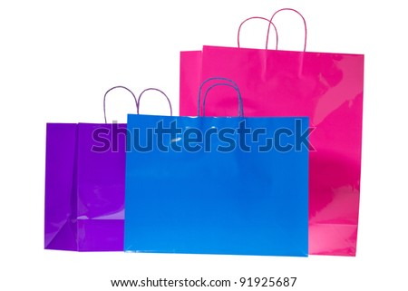 Three colorful gift or shopping bags isolated on a pure white background. - stock photo
