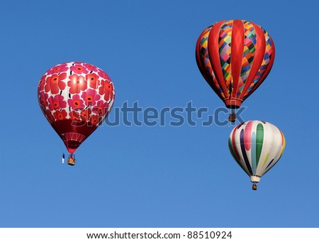 Three colorful hot air balloon against blue sky - stock photo