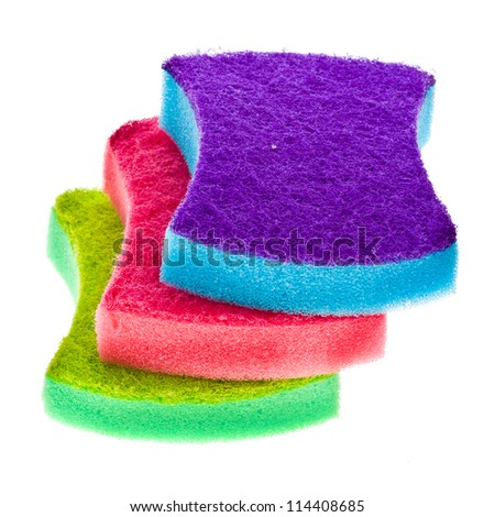 three colorful household sponges for washing dishes, isolated on a white background