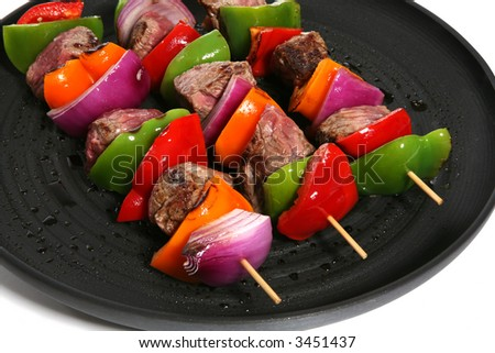Three colorful kabobs in a grilling in a pan over white - stock photo