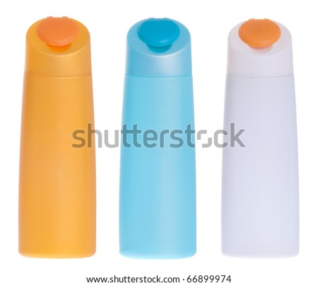 three colorful plastic bottles (could be shampoo, gel, sun tan, lotion) isolated on white background - stock photo