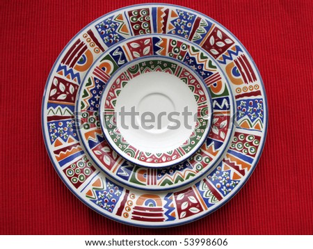 Three colorful plates in a red background - stock photo