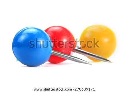 Three colorful round push pins on white background - stock photo