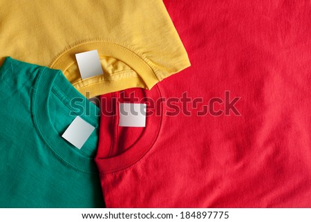 Three colorful t-shirts. Clean label, bright background