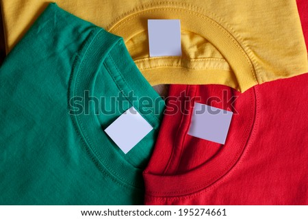 Three colorful t-shirts. Clean labels,  creative background.