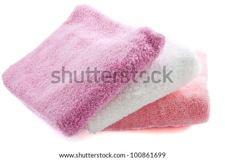 Three colorful towels on a white background - stock photo