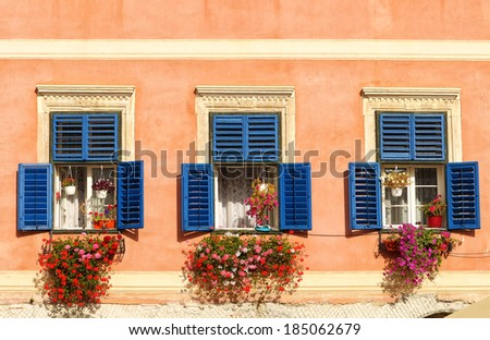 Three colorful windows