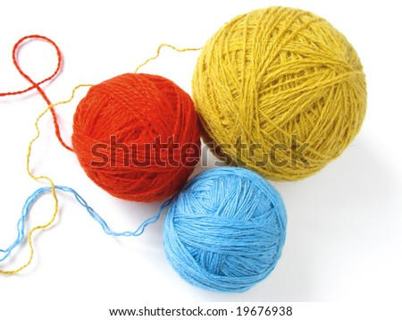 three colorful wool yarn skeins