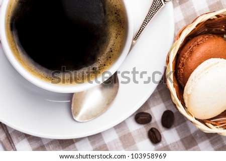 Three colors of macaroons in brown and beige tones - stock photo