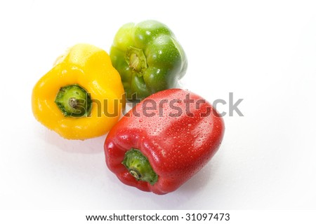 Three colors pepper on white background