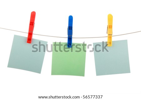 Three colour cards hang on clothespins is isolated on a white background