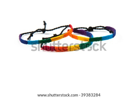 Three colourful friendship bracelets tied up.