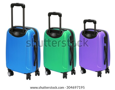 Three Colourful Luggages with Wheels Standing on White Background - stock photo