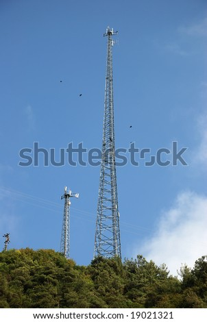 Three communication towers located top of the Mountain