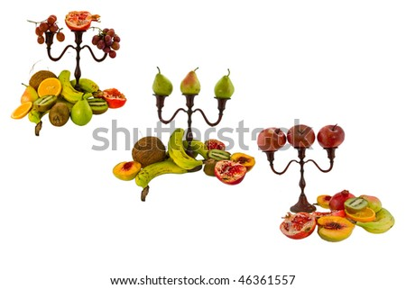 Three compositions on a white background from tropical fruit and candlesticks