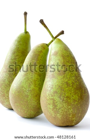 Three conference pears stood on end. Vertical composition - stock photo