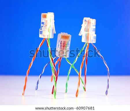 Three connectors RJ45 for network over blue. Shallow DOF. Abstract team concept