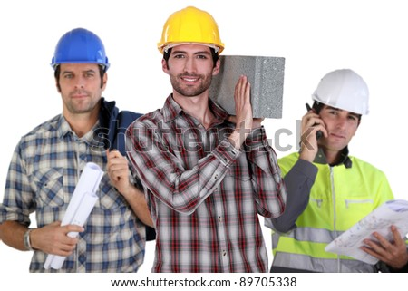 Three construction workers - stock photo