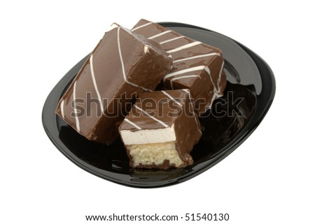 three cookie in chocolate on black plate isolated on white - stock photo