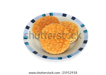 Three cookies on a plate - stock photo