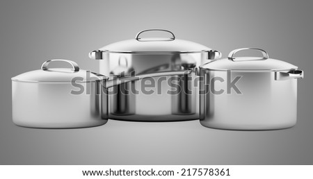 three cooking pans isolated on gray background