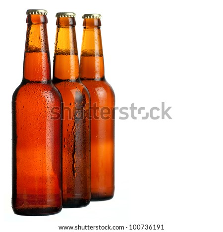 Three cool beer bottle, iIsolated on white. - stock photo