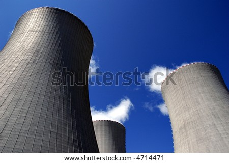 Three cooling towers of nuclear power station. - stock photo
