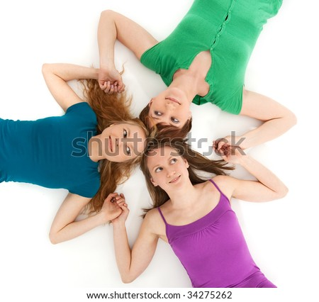 Three coquette girls holding hands and looking at each other. - stock photo