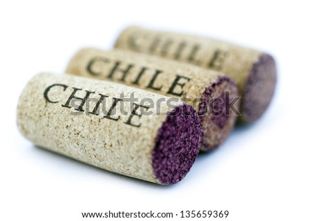 Three corks aligned in a row diagonally to the camera, isolated on white background. Very shallow depth of field. - stock photo