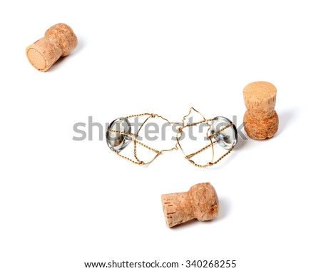 Three corks from champagne wine and muselets. Isolated on white background with copy space. Selective focus. - stock photo