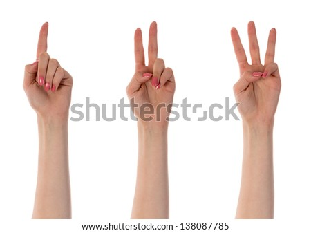 Three counting female hands isolated on white - stock photo