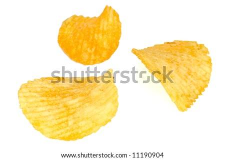 Three Crisp yellow potato chips isolated on white - stock photo