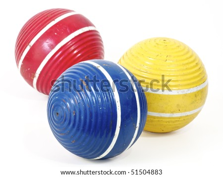 Three croquet balls, blue, red and yellow. Working path included. - stock photo