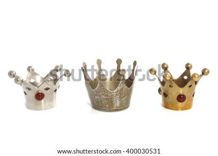 Three crowns in a row isolated over white - stock photo