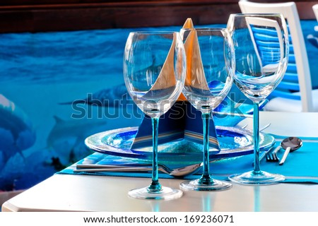 Three crystal wine glass on the table - stock photo