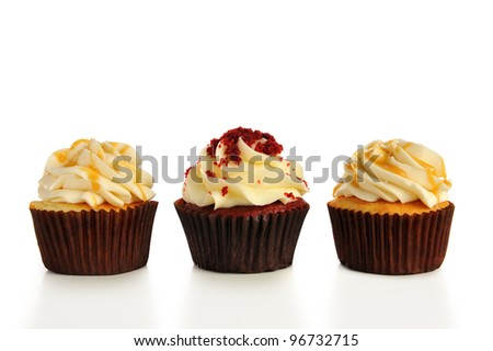 Three cupcakes in a row. - stock photo