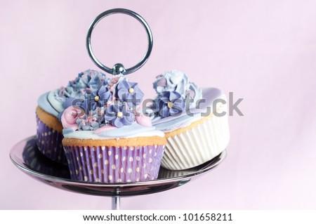 three cupcakes on a cupcake stand - stock photo